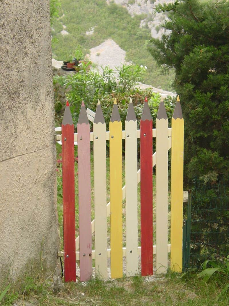 This variation of a white picket gate would work in many small gardens.
