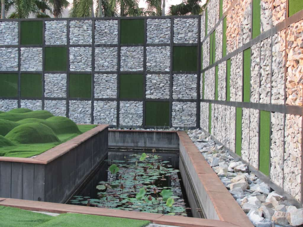 The walls are an amazing checkerboard of stacked rock and grass.
