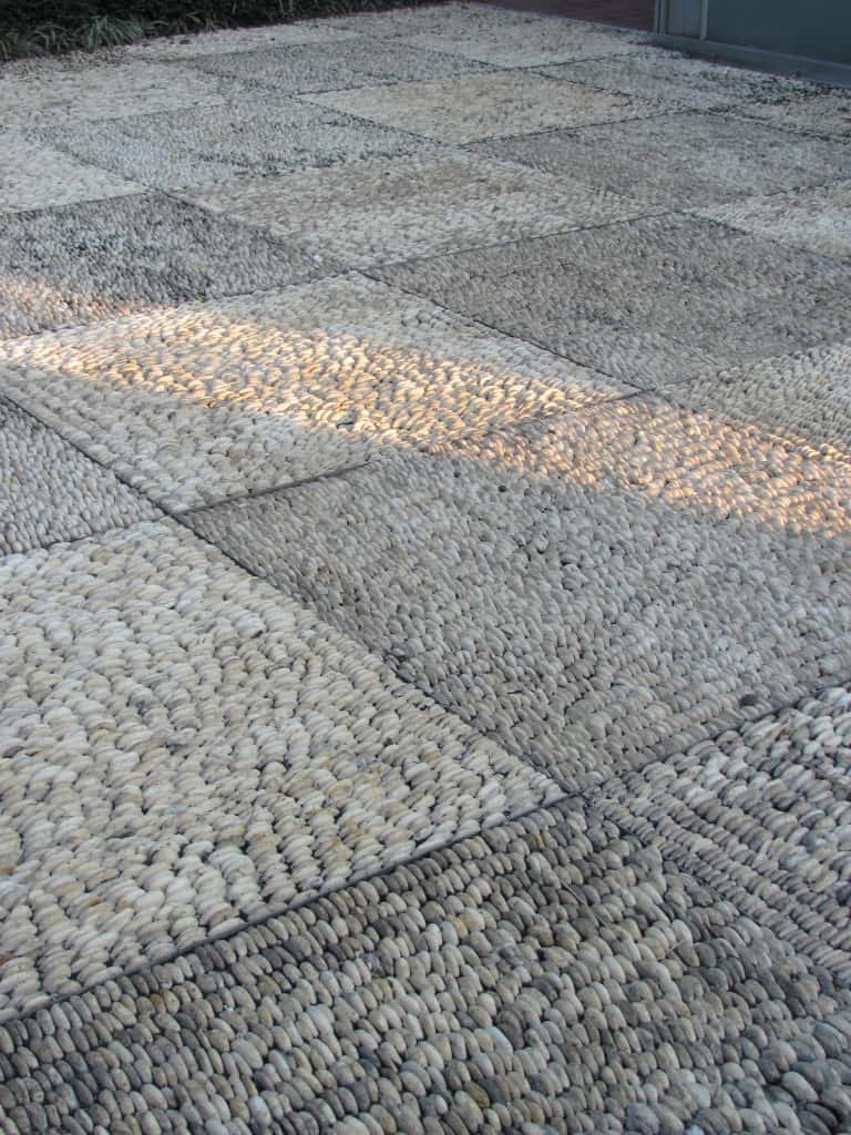 The pebbles turned on edge in this patio hardscape in the Spanish garden are amazing.
