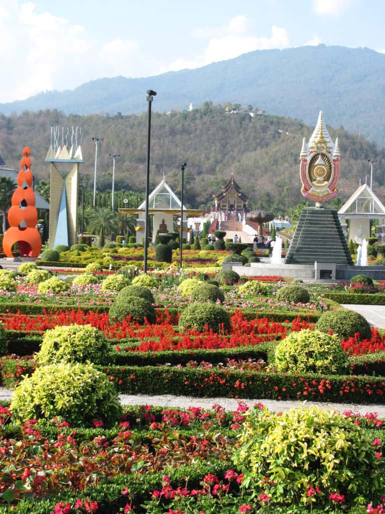 In this view of the main garden the Royal Pavilion is in the mid-ground and Doi Kham is the mountain in the background.